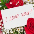 Roses bouquet and greeting card — Stock Photo #65004763