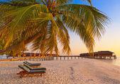 Loungers on Maldives beach — Stock Photo