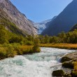Waterfall near Briksdal glacier - Norway — Stock Photo #70219721