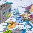 Europe map and travel case with stickers (my photos) — Stock Photo #71909695
