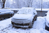 Word help on snow covered car — Stock Photo
