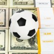 Money and soccer ball — Stock Photo #74168397