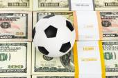Money and soccer ball — Stock Photo
