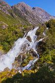 Waterfall near Briksdal glacier - Norway — Stock Photo