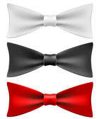 White, black and red bow ties — Stock Vector