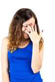 Embarrassed girl covers her face with palm — Stock Photo