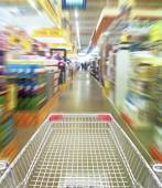 Shopping cart in motion — Stock Photo