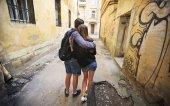 Couple on old street — Stock Photo