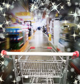 Shoping cart with christmas lights — Photo