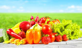Fruits and vegetables on wooden table — Stock Photo