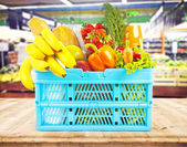 Basket with food in supermarket — Stockfoto