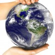 Two woman hands protect earth — Stock Photo #69454227