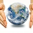 Two woman hands protect earth — Stock Photo #69454285
