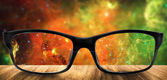 Clear glasses with blurred NASA space — Stock Photo
