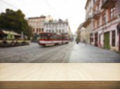 Wooden desk and blurred city — Stock Photo