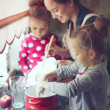 Mother with kids at the kitchen — Stock Photo #55615435