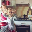 Mother with kids at the kitchen — Stock Photo #55615743