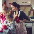 Mother with kids at the kitchen — Stock Photo #55615859