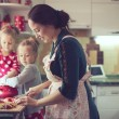 Mother with kids at the kitchen — Stock Photo #55616261