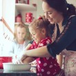 Mother with kids at the kitchen — Stock Photo #55616387