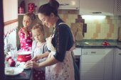 Mother with kids at the kitchen — Photo