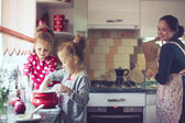 Mother with kids at the kitchen — Stock Photo