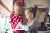 Kids at the kitchen — Stock Photo