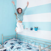 Kid girl jumping on bed — Stock Photo