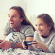 Child playing video game with father — Stock Photo #64380595