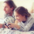 Child playing video game with father — Stock Photo #64380609