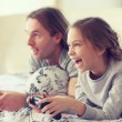 Child playing video game with father — Stock Photo #64380677
