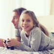Child playing video game with father — Stock Photo #64380715