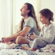 Child playing video game with father — Stock Photo #64380767
