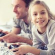 Child playing video game with father — Stock Photo #64380795
