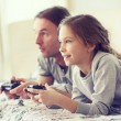 Child playing video game with father — Stock Photo #64380833
