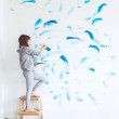 Child painting wall — Stock Photo #68771957