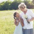 Great-grandmother and granddaughter — Stock Photo #73524591