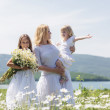 Family in flower field — Stock Photo #73524747