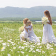 Family in flower field — Stock Photo #73524757