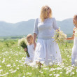 Family in flower field — Stock Photo #73524761
