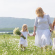 Family in flower field — Stock Photo #73524763