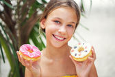 Girl eating donuts — Stock Photo