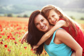 Mother with her child in sunlight — Stock Photo