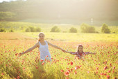 Mother with her child in spring field — Stock Photo