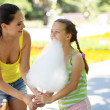 Eating cotton candy — Stock Photo #74730791