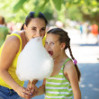 Eating cotton candy — Stock Photo #74730805