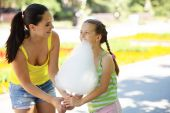 Eating cotton candy — Stock Photo