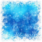 Christmas snowflakes pattern in blue — Stock Vector