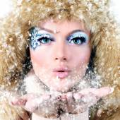 Winter portrait of girl in a fur hat — Stock Photo