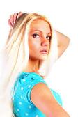 Woman in a blue dress — Stockfoto